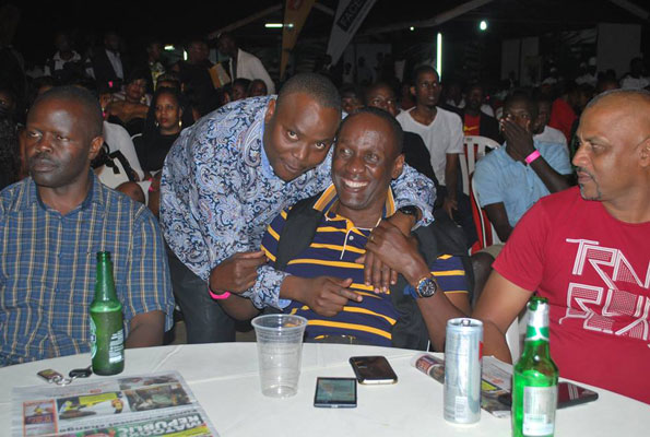 Min.-Ronald-Kibuule-having-a-light-moment-with-Capt.-Mike-Mukula