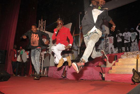 Aganaga (C) works the crowd with an energetic performance. PHOTO BY MICHAEL KAKUMIRIZI
