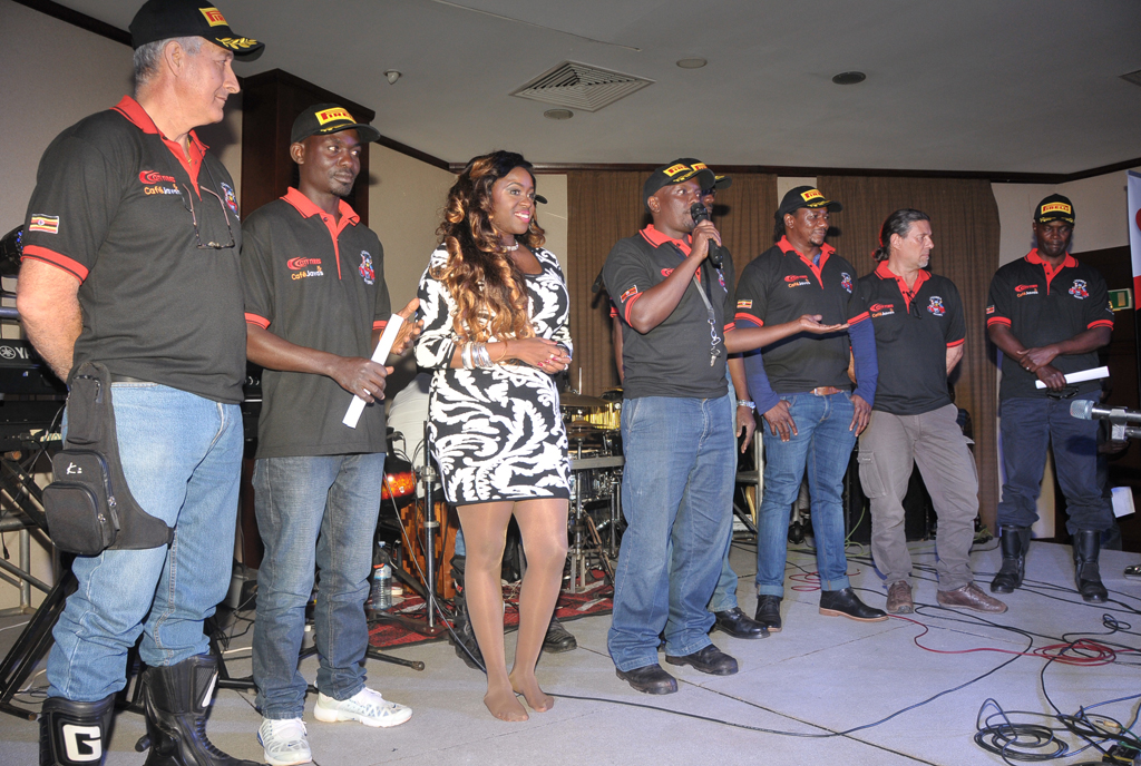 Angella Katatumba on stage with members of Uganda Bikers Association, who jointly organised the concert with Uganda Cancer Institute. PHOTO BY MICHAEL KAKUMIRIZI