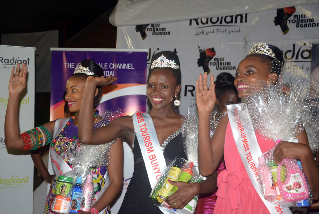 Left to right: Miss Tourism Bunyoro second runner up Dinah Kugonza Amooti, the winner Stella Atine and first runner up Catherine Kente. PHOTO BY LAWRENCE OGWAL