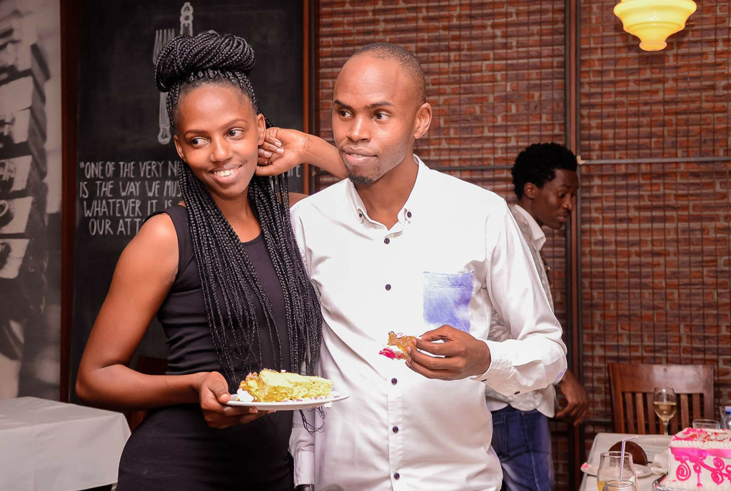 Muhangi and Asiimwe during a social function.  PHOTO by Isaac Ssejjombwe