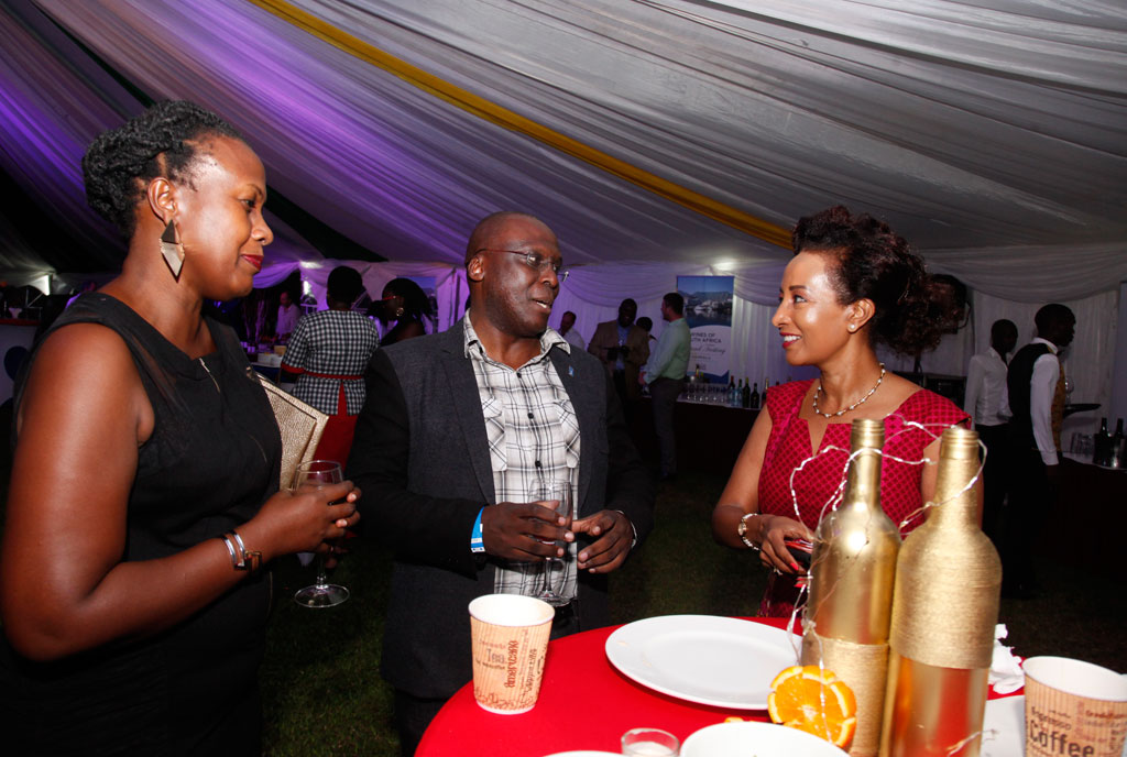 Monitor Publications Ltd's Judith Komuhendo and Richard Senkwale have a chat with festival organiser Yogi Birigwa (R). Photo by Rachel Mabala