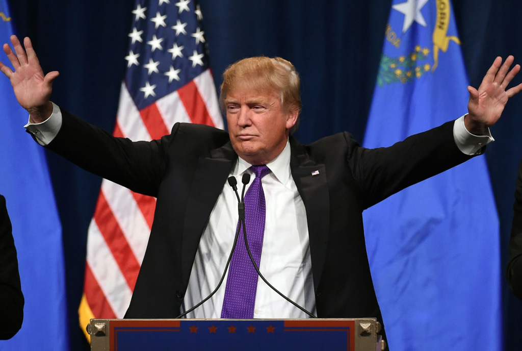 """LAS VEGAS, NV - FEBRUARY 23:  Republican presidential candidate Donald Trump speaks at a caucus night watch party at the Treasure Island Hotel & Casino on February 23, 2016 in Las Vegas, Nevada. The New York businessman won his third state victory in a row in the """"first in the West"""" caucuses.  (Photo by Ethan Miller/Getty Images)"""