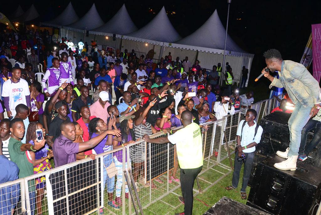 Bobi Wine performing at Purple Party. Photos by Michael Kakumirizi