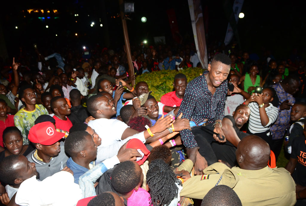 Chameleone mobbed by crowds during his performance. Below, some of the fireworks display at Sheraton Kampala Hotel. PHOTOS BY MICHAEL KAKUMIRIZI