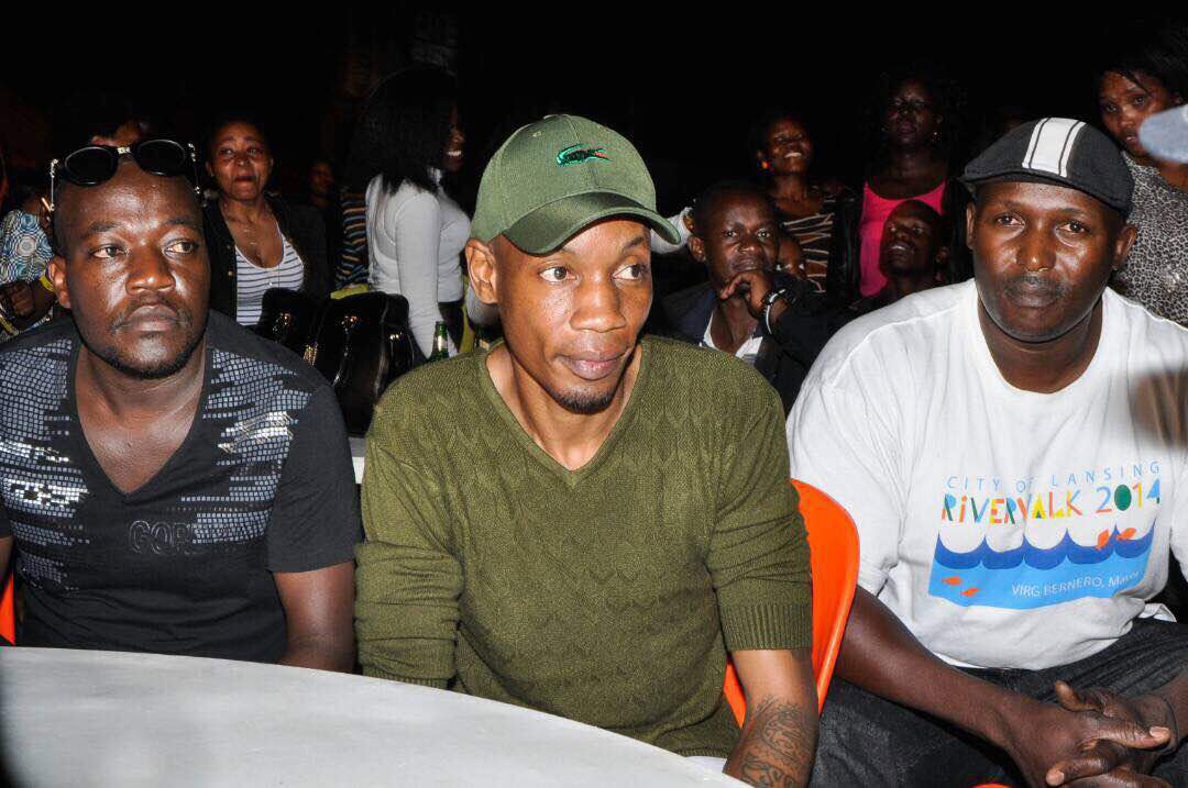 Young tycoon Bryan White (C) and his personal security at the Radio & Weazal 10 years anniversary concert