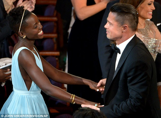 Lupita Nyong'o hugs Brad Pitt at the Oscars in 2014