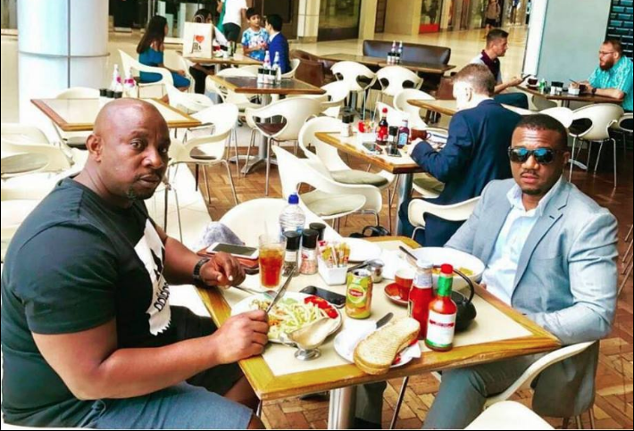 Roy Mubiru (Left) having dinner with Cameron Gitawo. Courtesy Photo