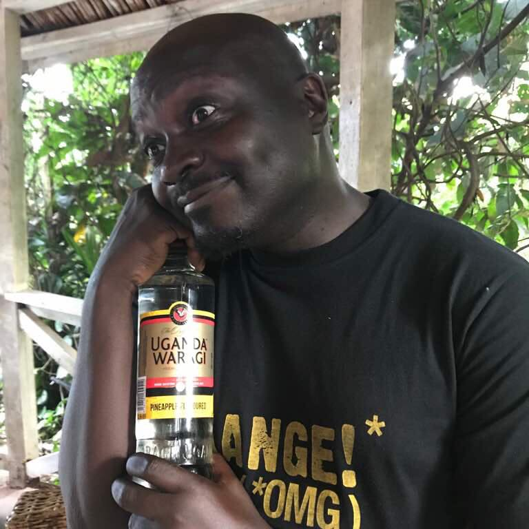 Dibo Nakuzambwa Brown poses with a photo of Uganda Waragi Pineapple flavour