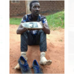 Qute Kaye holding the headlight that he was caught stealing