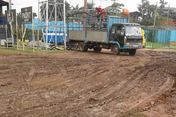 Messy field of play. Skid marks on the cricket oval outfield of Lugogo caused by trucks organising Zoe Fellowship
