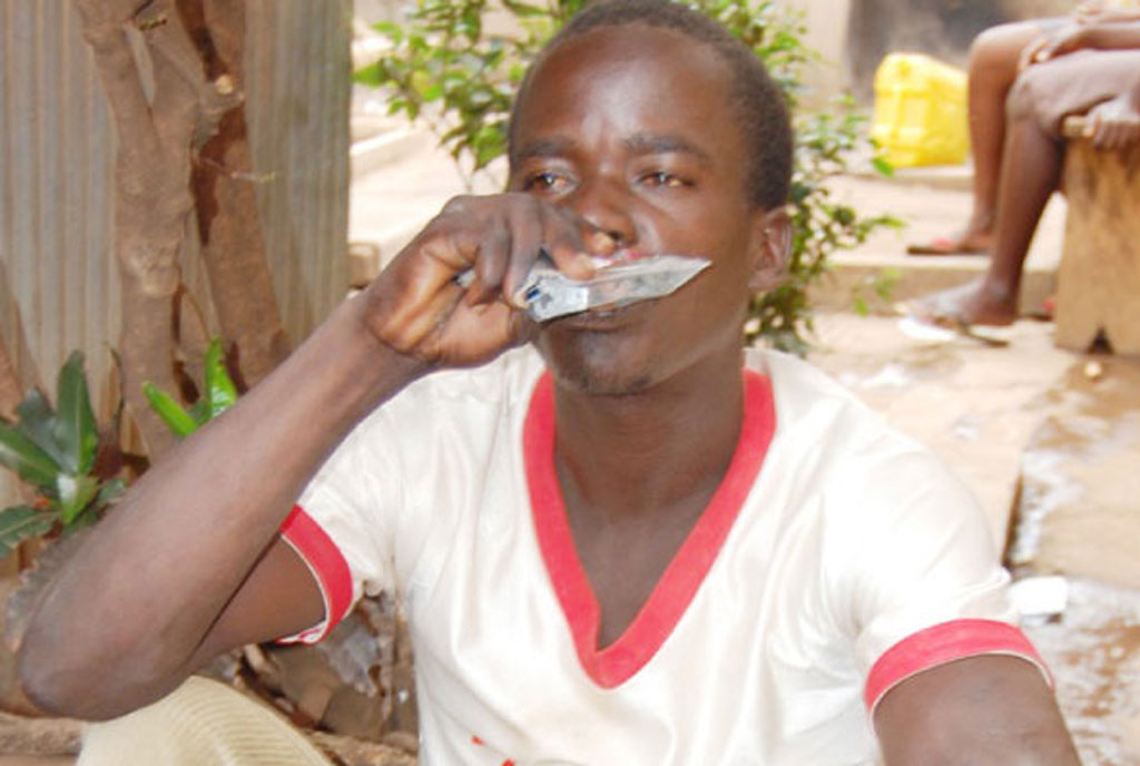 A man drinks alcohol in a sachet in Lira. FILE PHOTO
