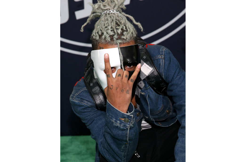 In this file photo taken on October 05, 2017 showing rapper XXXTentacion attending the BET Hip Hop Awards 2017 at The Fillmore Miami Beach at the Jackie Gleason Theater in Miami Beach, Florida