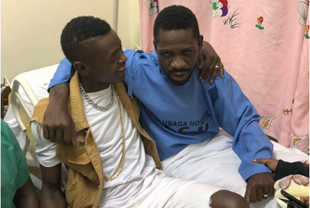 Jose Chameleone with Robert Kyagulanyi on his hospital bed at Lubaga Hospital
