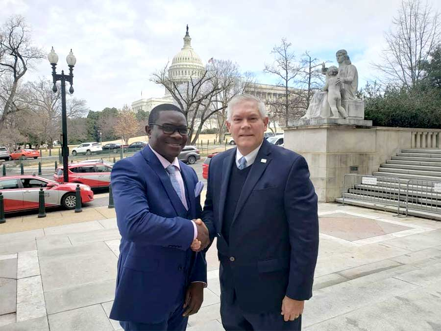 Men of importantance . Mr Pemba (L)shakes hands with Peter Anderson, an American politician from Texas who served in the US House of Representatives for 11 terms,soon after the important meeting at Washington DC senate