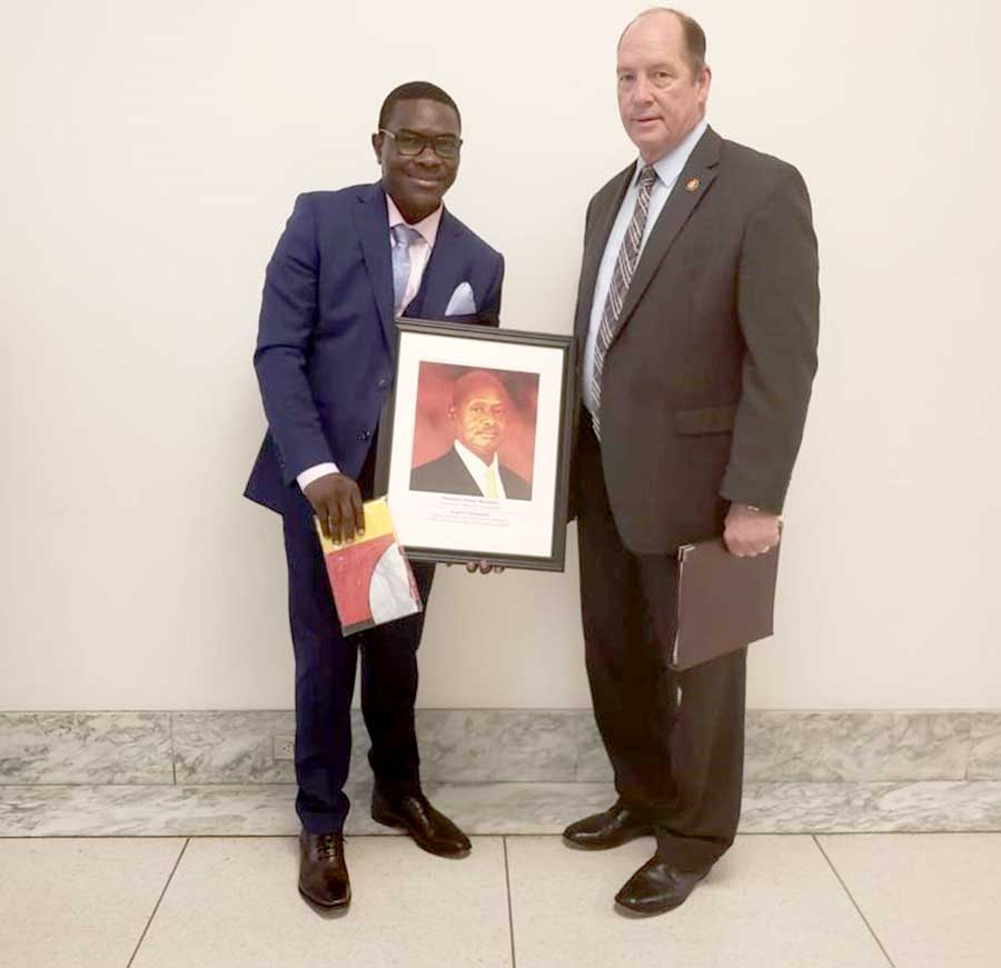 Pemba sealed his meeting with the high caliber personalities by handing over a Ugandan flag and President Museveni portrait to Mr. Theodore Scott Yoho (R), a US Representative for Florida T.C District