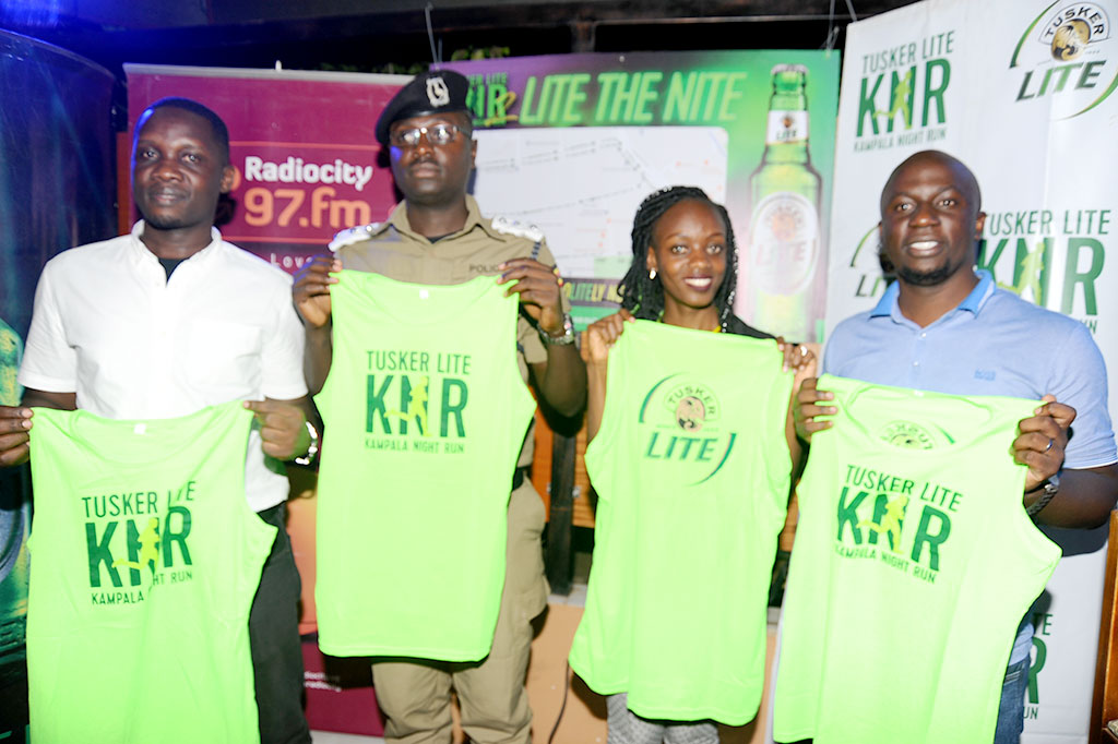 Radio City's Kevin Masaba(L) Kampala Metropolitan police spokesperson, Mr Luke Owoyesigyire (2ndL)  UBL Brand Manager, Premium Beers  Ms Cathy Twesigye (2ndR)and Muchachos Solutions Ronald Kivumbi at the Official launch at Route 256 on May 2 (PHOTO BY EDDIE CHICCO)